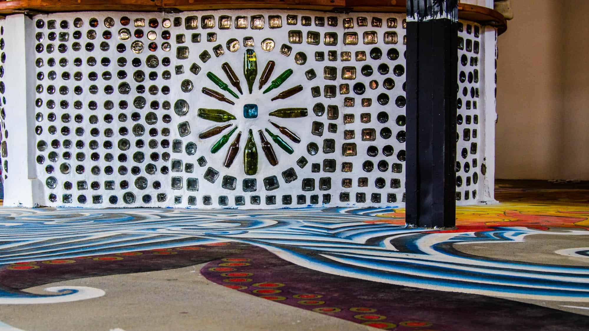 Recycled bottles were used to create art and structure for the bar.